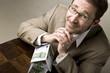 Leinwanddruck Bild - Junger Mann mit Haus aus Geldscheinen