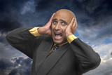 Desperate businessman with a stormy sky as background poster