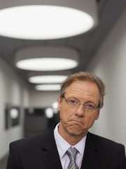 Businessman frowning in office
