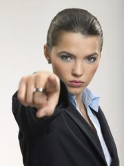Businesswoman pointing finger