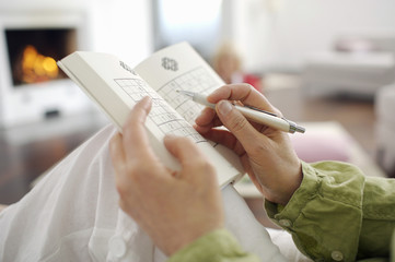 Close-up of woman playing Sudoku