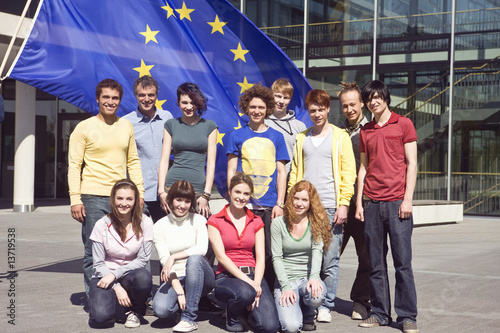 Group portrait of teenagers and young adults before an EU flag in Munich, Bavaria, Germany