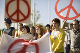 Group of young people holding banner at peace demonstration in Munich, Bavaria, Germany