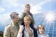 Family posing together in front of solar panels in Munich, Bavaria, Germany