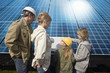 Family looking at plans laid on solar panels in Munich, Bavaria, Germany