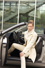 Mature adult woman sitting in convertible, Munich, Germany