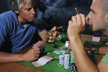 Two men playing poker, studio shot