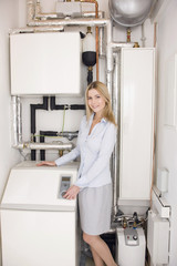 Woman standing next to a water softener
