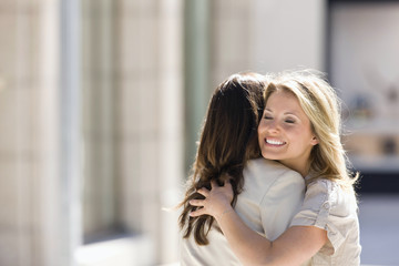 Two women hugging, Stuttgart, Baden-Wurttemberg, Germany