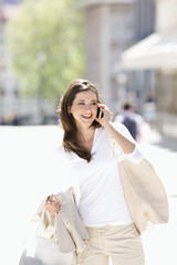 Young woman talking on cell phone, outdoors, Stuttgart, Baden-Wurttemberg, Germany