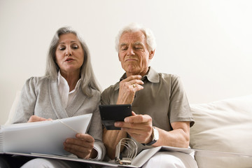Senior couple calculating finances