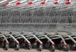 Row of supermarket shopping cart trolleys