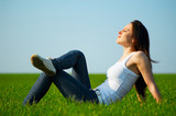 carefree girl sitting at the field poster