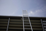 Low angle view of ladder leaning against building