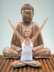 Portrait of young adult woman practicing yoga with Buddha, studio shot