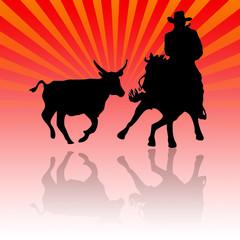 Vaquero llevando vacas