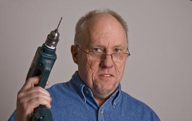 Older Man Holding Power Drill