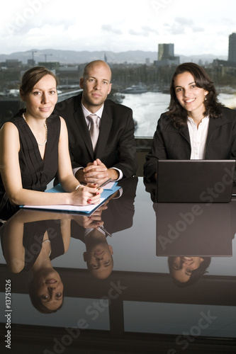 Businessteam with reflex on table