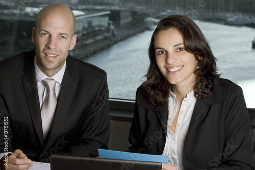 Two Businesspeople in front of a harbour