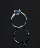 blue sapphire ring with reflection poster