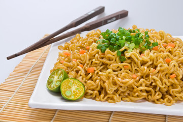 Asian noodle dish (Pancit) with Philippine lime on the side