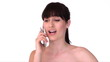 Young beautiful woman is talking cell phone