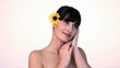Young beautiful woman posing with yellow flower