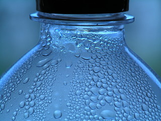 Blue water drops on the Bottle