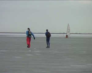 Ice sailing and skating on the Gouwzee in the Netherlands
