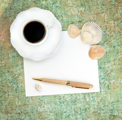 Coffee with Paper, Pen and Shells