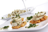 Calamari in garlic sauce over toasted plantain poster