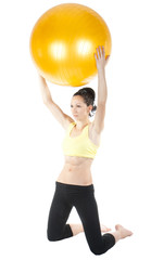 beautiful young woman exercising with ball