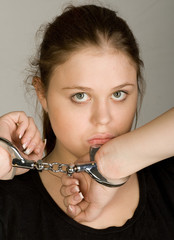 Handcuffed young beautiful woman