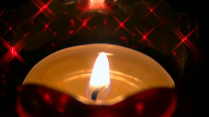 Candle in the dark with shining stars HD