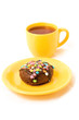 chocolate cake on the yellow plate and cup of tea