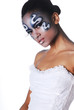 Portrait of beautiful mulatto girl with body art on her face