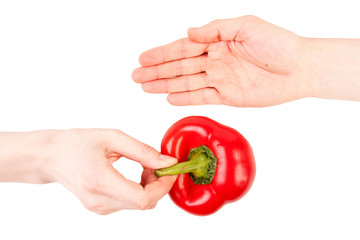 Hand passing pepper to another hand