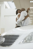 Portrait of an African American couple purchasing a car