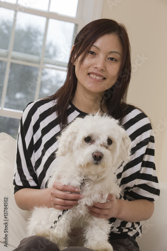 Portrait of a Chinese woman and her dog