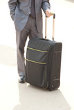 Unrecognizable man with suitcase. poster