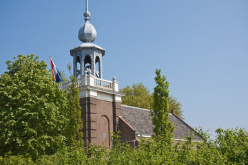 Old church with tri-color in the Netherlands
