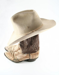 Old cowboy boots and hat top side view