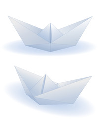 Two realistic paper ships isolated on white