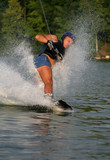 Man Wakeboarding on the lake
