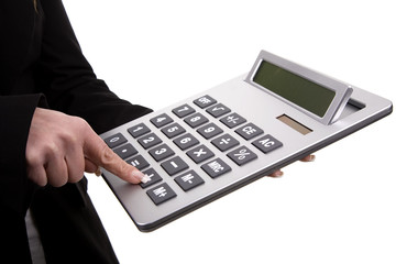 businesswomanÕs fingers touching calculator buttons