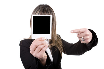 woman holding a photo in front of his face