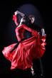 dancers in action against black background