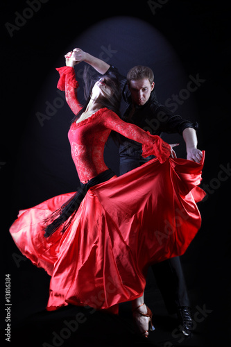 dancers in action against black background