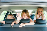 Family travelling by car