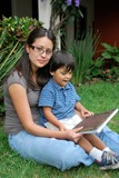 HIspanic mother and young son reading together